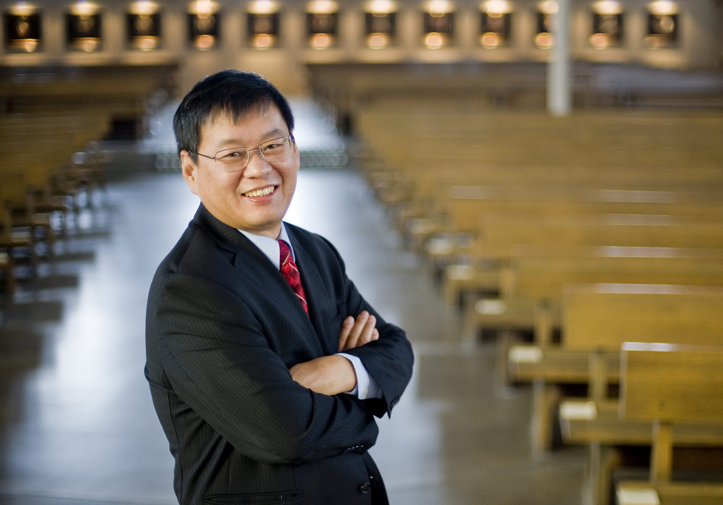 """Fenggang Yang, a professor of sociology and director of Purdue's Center on Religion and Chinese Society, is the author of """"Religion in China: Survival and Revival Under Communist Rule."""" Yang, who was one of the first to study the sociology of religion in China, has been collecting data since 2000. His new book, which was published by Oxford University Press this fall, looks at religion under communism from the 1950s to 2010. (Purdue University photo/Andrew Hancock)"""